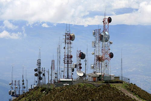 Several communications towers on top of a hill