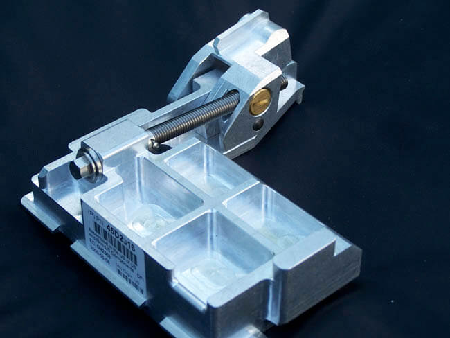 Actuation of the screw raises and lowers the stop