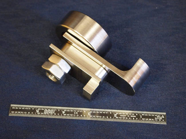 Purchased linear bearing assembled onto machined components